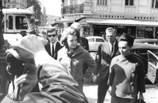 Princess Irene walking in the street with a woman and men behind her, 1964.