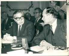 Lord George Brown talking with Baron Chalfont in a meeting