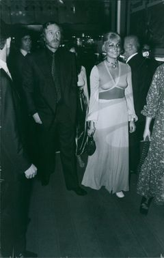 Richard St John Harris with a woman seen arriving at a party.