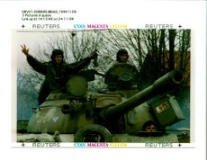 Bosnian Serb soldiers show the three finger sign.