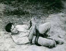 Gil Delamare fighting with a snake.