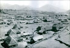 An aerial view of huts in the village.