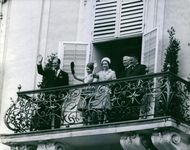 Elizabeth II and Prince Philip, Duke of Edinburgh, with unknown men and woman at the balcony.
