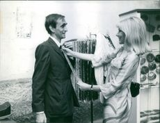 Susan Hampshire choosing tie for a man.