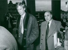British surgeon Dr. Richard Arnot arriving at the Helen Smith inquest in Leeds with his solicitor, Sir David Napley (right). 1982.