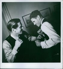 Two men boxing and smiling. 1943