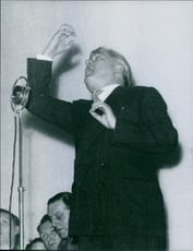 A photo of  a Welsh Labour Party politician who was the Minister for Health in the post-war Attlee government from 1945 to 1951 Aneurin Bevan giving speech passionately on stage.