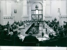 People sitting together and having communication during a meeting.