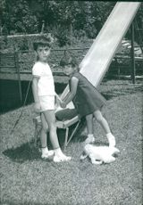 Young Prince Reza and Princess Farahnaz Pahlavi playing in the playground.