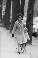Jacques Charrier with his mother, riding a toy bicycle,