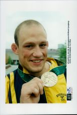 Winner Mikaael Ljunberg proudly shows up his winning medal.
