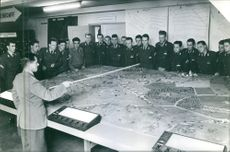 German Senior official instructs army soldiers the location of the target during a war in Berlin, 1960