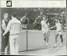 German captain Wilhelm Burgert thanks Hasse Olsson and Michael Westphal thanks Mats Wilander after match in Davis Cup
