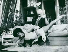 Eartha Kitt like Bunny Novak here with her opponent David Kossof, like in a scene, gives her a touch
