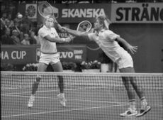 Jan Gunnarsson and Michael Mortensen in action during a double match in Stockholm Open 1984