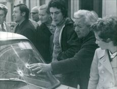 1972 Milan: Bank assault at 10 o'clock . After two hours two of the four gangsters caught. two escaped. After the manhunt, An elderly woman touches one of the holes in the windscreen of the Automobile, It was a stolen car.