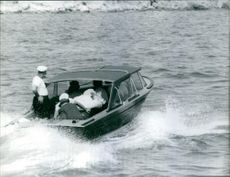 Stavros Niarchos in a motorboat with his crew.