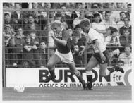 Paul Kerr and Paul Blades are fighting for the ball