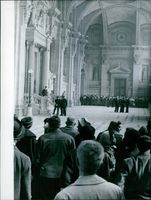 People and policemen gathered in the hall. 1960