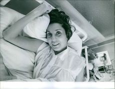 Vintage photo of Nelly Galvan lying on bed. Photo taken on March 6, 1961.