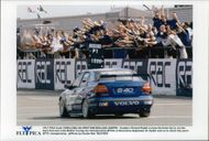 Rickard Rydell crosses the finish line in the first race of two in the Silverstone BTCC competition.
