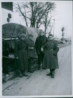 Soldiers standing together beside of the cart in Hungary during World War II, 1946.