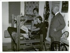 """Major Liebrath looks at the loom at the exhibition """"Youth of Today"""""""