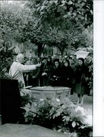 A priest sprinkles holy water as he blesses the coffin of Selwood's father, 1962.