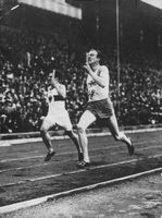 Track athletes during Olympics race.  - 1934