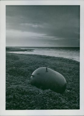Unexploded mine at sea shore in dawn in Sweden 1939.