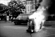 A burning car at the riots in Brixton