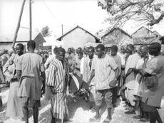 A group of Africans carrying a cadaver.  Republic of Senegal  is a country in West Africa. Senegal's economical and political capital is Dakar. It is the westernmost country in the mainland of the Old World, or Eurafrasia