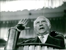 Konrad Hermann Joseph Adenauer addressing people.