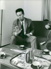Ahmed Ben Bella sitting on couch.