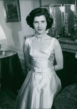 Princess Jean-Charles De Ligne smiling and posing for the camera, her arms hidden at the back.