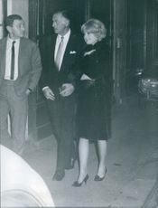 Stewart Granger walking with Caroline Lecerf.