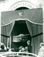 Maurice Chevaliers coffin the cage at burial