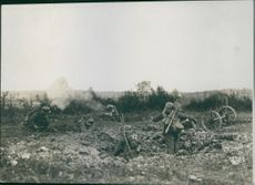 Soldiers in the field while using a cannon during First World War, 1936.