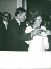 beatrix and Claus of the Netherlands toasting.