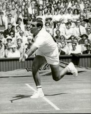 OK Davidson (Australia) plays against M. Santana (Spain) during the Wimbledon Championship