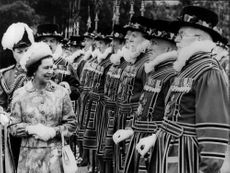 "Queen Elizabeth II inspects his choir ""Yeomen of the Guard"" outside Buckingham Palace"