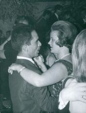 King Hussein dancing with his wife Princess Muna al-Hussein at a party. 1964.