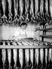 A worker hangs mackerel in the fish factory in Bremerhaven