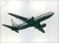 Boeing 737 airplane in flight.