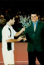 Pete Sampras receives the prize for the win in the Open de Paris.