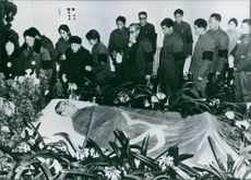 Mourners filing past the body of Zhou Enlai, as it lies in the state in Peking. The Chinese Premier died of cancer in January 1976, at the age of 77. 1976