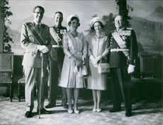 Princess Alexandra standing with three general.