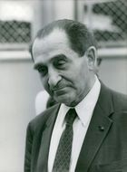 Pierre Mendès France pictured with his head slightly tilted while looking down.