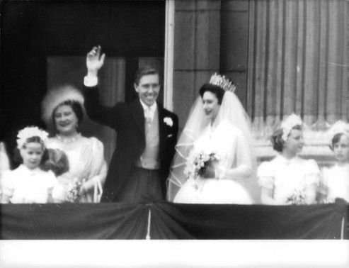 Princess Margaret and Earl of Snowndon standing on balcony on their wedding day with the Queen mother.