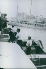 1970 Stavros Niarchos a multi-billionaire Greek shipping tycoon getting down from boat